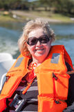Portrait of a woman in  life jacket Stock Images