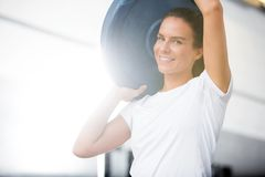 Portrait Of Woman Lifting Barbell Plate Royalty Free Stock Images
