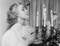 Portrait of woman lighting candles Royalty Free Stock Photo
