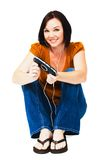 Portrait of woman listening media player. Portrait of a woman listening to music on an media player isolated over white Stock Images