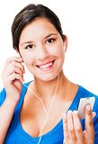 Portrait of a woman listening mp3. Portrait of a woman listening to music on an mp3 player isolated over white Royalty Free Stock Photos
