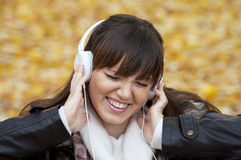Portrait of a woman listening music Royalty Free Stock Images