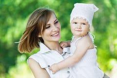 Portrait woman little girl Stock Photos