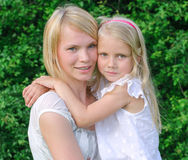 Portrait of woman and little girl Stock Images