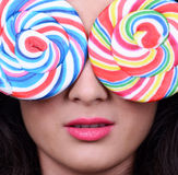 Portrait of woman with lollipop glasses Royalty Free Stock Image
