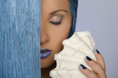 Portrait of woman with long blue hair and shells Royalty Free Stock Photography