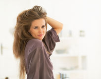 Portrait of woman with long hair looking in mirror. Portrait of young woman with long hair; long hair looking in mirror Stock Image