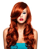 Portrait  of a  woman with long red hairs Royalty Free Stock Photo