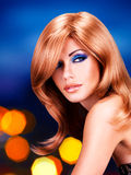 Portrait of a  woman with long red hairs and  fashion makeup Royalty Free Stock Image