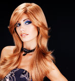 Portrait of a  woman with long red hairs and  fashion makeup Stock Images