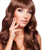 Portrait  of  a woman with long red hairs with fingers at face Royalty Free Stock Photos