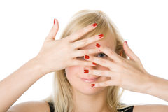 Portrait of  woman looking through fingers Royalty Free Stock Photos