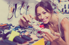 Portrait of  woman looking after pair of shoes for kid Stock Photo