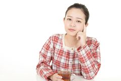 Uneasy Asian woman. Portrait of woman looking uneasy royalty free stock photography