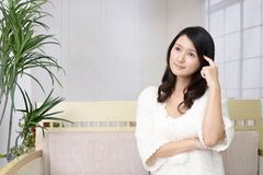 Uneasy Asian woman. Portrait of woman looking uneasy royalty free stock photo