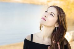 Portrait of a woman looking up, dreaming, hopeful. Portrait of a woman looking up, hopeful, dreaming, outdoors Royalty Free Stock Images