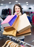 Portrait of woman with a lot of shopping bags Stock Images