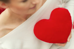 Portrait of woman in love and red heart - Valentine Day. Alone Royalty Free Stock Photography
