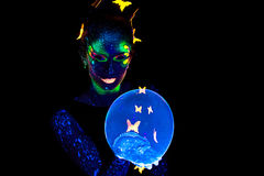 Portrait of woman with luminous make up and bubble Stock Images