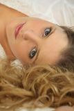 Portrait of a woman lying down. Portrait of a blond woman lying down Royalty Free Stock Images