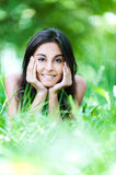 Portrait woman lying grass Royalty Free Stock Photos