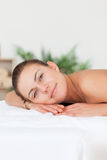 Portrait of a woman lying on her belly Royalty Free Stock Images