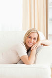 Portrait of a woman lying on her sofa Royalty Free Stock Image