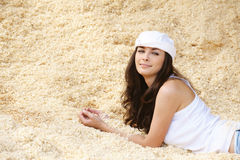 Portrait of woman lying in sawdust Stock Image