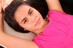 Portrait woman lying up Stock Photography