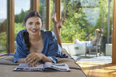 Portrait Of Woman With Magazine By Windows Stock Photos