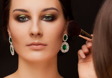 Portrait of woman with make-up and make-up artist Royalty Free Stock Photos