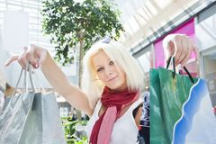 Portrait of woman at the mall with bags copyspase Royalty Free Stock Image