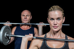 Portrait of woman and man lifting crossfit Royalty Free Stock Images