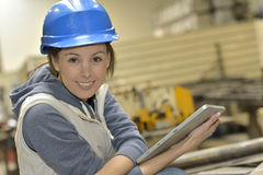 Portrait of a woman in manufacture using digital tablet Royalty Free Stock Photography