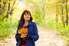 Portrait of   woman with maple. Outdoor portrait of   woman with maple posy Stock Images