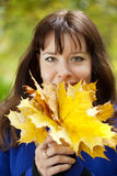 Portrait of woman with maple posy. Outdoor portrait of happy woman in autumn with maple posy stock photos