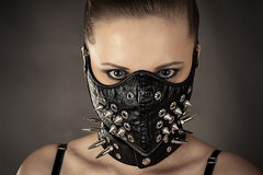 Portrait of a woman in a mask with spikes. Isolated on gray Stock Images