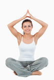Portrait of a woman in a meditation position stock images