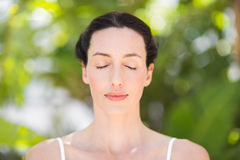 Portrait of a woman in a meditation position Stock Image