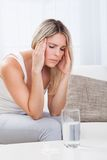 Portrait of woman with migraine Royalty Free Stock Images