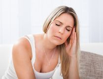 Portrait of woman with migraine Royalty Free Stock Photography