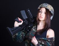 Portrait of a woman in a military uniform with an assault rifle Royalty Free Stock Image