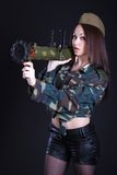 Portrait of a woman in a military uniform with a grenade launche Stock Image