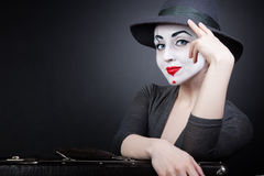 Portrait of woman mime with a suitcase Royalty Free Stock Images