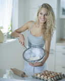 Portrait of woman mixing cookie batter in kitchen at counter Stock Images