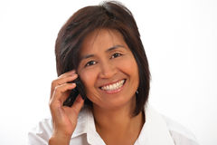 Portrait of a woman with a mobile. Portrait of a happy smiling young Asian woman with a mobile phone Stock Images