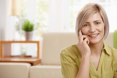 Portrait of woman with mobile phone Royalty Free Stock Images