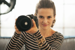 Portrait of woman with modern dslr photo camera Stock Photos