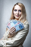 Portrait of woman with money Stock Image