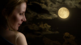 Portrait of a Woman, by moonlight. Sky, moon and clouds stock images